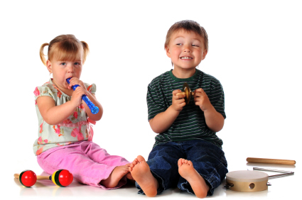 Children Enjoying Playing some instruments in a preschool music lesson