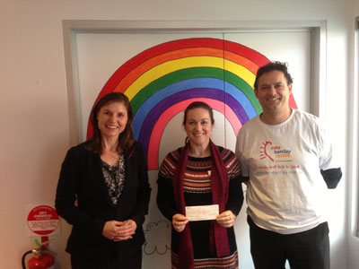 Janice Tuck meeting staff and presenting a donation cheque to the Cora Barclay centre for hearing impaired children.